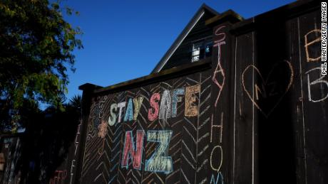 A house fence has been chalked up with messages relating to the Covid-19 lockdown on April 3, 2020 in Auckland, New Zealand.