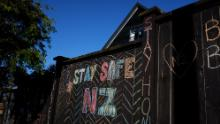 A house fence chalked up with messages relating to the Covid-19 lockdown on April 3, 2020 in Auckland, New Zealand.