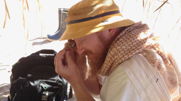 Erik Seiffert inspecting a tiny fossil at the Santa Rosa site in Amazonian Perú. [Credit: Dorien de Vries]