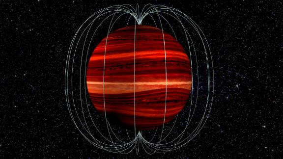"This is an artist's illustration of a brown dwarf, or a ""failed star"" object, and its magnetic field. The brown dwarf's atmosphere and magnetic field rotate at different speeds, which allowed astronomers to determine wind speed on the object."