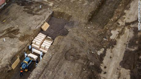 Drone images show bodies being buried on New York's Hart Island on Thursday.