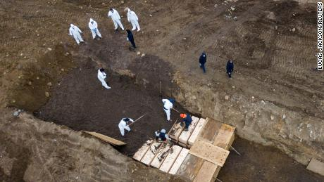 Drone pictures show bodies being buried on New York's Hart Island on April 9, 2020. It's not known if these were coronavirus victims.