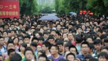 Students walk out from a schoolyard after finishing the first subject of the 2013 university entrance exam in Hefei, north China's Anhui province.
