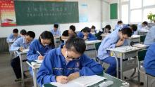 Students take a simulated college entrance exam in Handan in China's northern Hebei province on June 6, 2017.