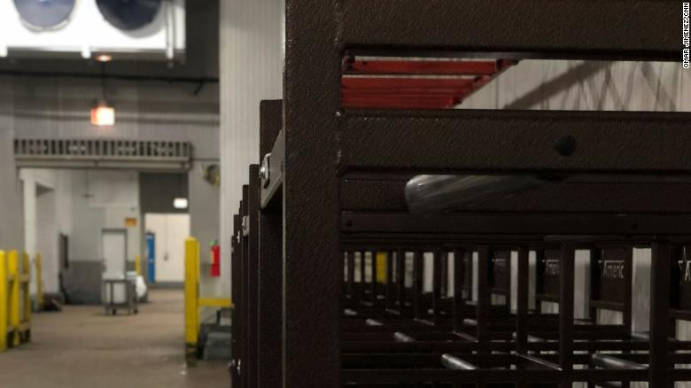 """Three-tiered racks for bodies to be transported and worked on in the """"surge center,"""" which is located in a warehouse outside of Chicago."""