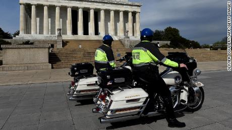 US Capitol police officers patrol near the Lincoln Memorial and National Mall due to concerns with the spread of the coronavirus.