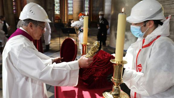 Notre Dame cathedral rector Patrick Chauvet repositions the Crown of Thorns, a relic of the passion of Christ, after a meditation ceremony to celebrate Good Friday in a secured part of Notre Dame on April 10.