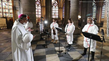 From left to right, Archbishop of Paris Michel Aupetit speaks with violonist Renaud Capucon, actor Judith Chemla and actor Philippe Torreton as during a meditation ceremony to celebrate Good Friday.