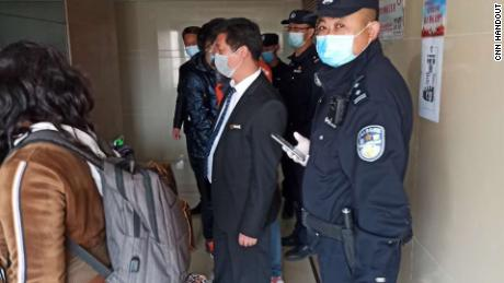 Police come to the house of an African resident in Beijing.