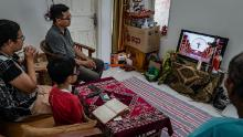 A family attends a prayer from their home during Good Friday service through live internet streaming on April 10, 2020, in Yogyakarta, Indonesia.