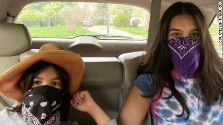 My masked daughters, 8 and 15, prepared for an outing.
