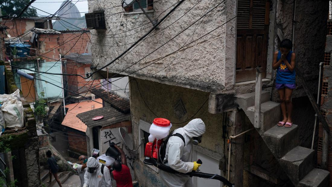 Volunteers spray disinfectant in a favela in Rio de Janeiro on April 10.