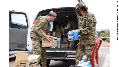 Arizona National Guard soldiers load PPE into a van destined for Shiprock, New Mexico, on Navajo Nation land.