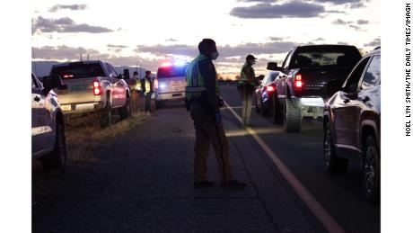Police on Navajo Nation set up checkpoints to share information on a weekend-long curfew to combat the spread of coronavirus.