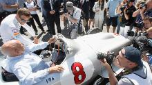 Stirling Moss and 2009 F1 world champion Jenson Button were the centre of media attention at the Goodwood Festival in 2015.