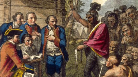 Pontiac, an Ottawa Indian, confronts Colonel Henry Bouquet, a leader of the British forces, who had authorized his officers in the 1700s to spread smallpox amongst Native Americans by infecting blankets.