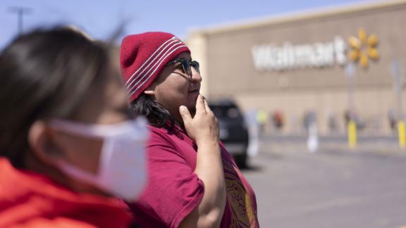 Navajo Nation tribal member Chris Long, 32, and his girlfriend Shannon Monroe, 30, shop on April 11, 2020, at Walmart in Winslow, Arizona.