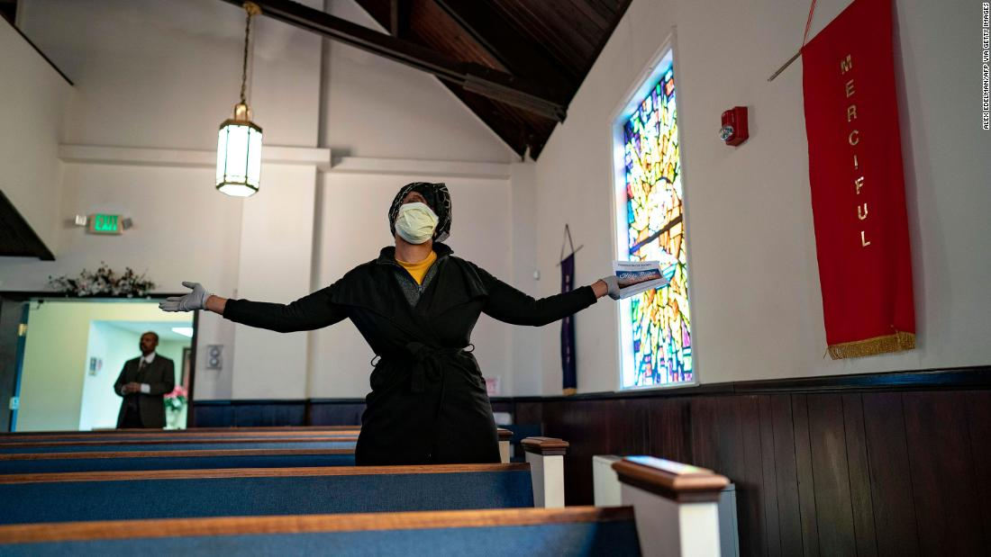 A woman worships during a service at Friendship Baptist Church in Baltimore.