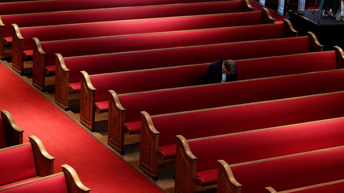 A man sits alone while attending an Easter service at Trinity Baptist Church in San Antonio, Texas.