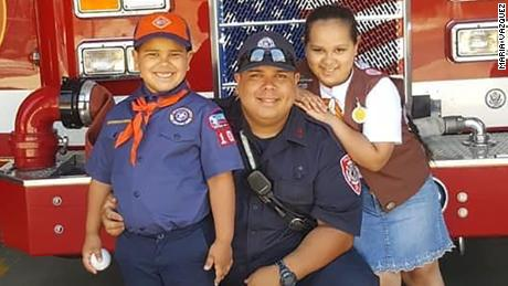 Late firefighter Israel Tolentino Jr. (center), and his two children. Tolentino Jr., of Passaic, New Jersey, died from complications due to the novel coronavirus, his wife said.