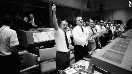 Mission Control erupts into cheers and applause as the Apollo 13 astronauts return to Earth.
