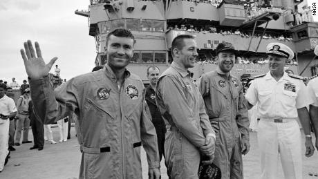 The USS Iwo Jima was the prime recovery ship for the Apollo 13 mission. The crewmembers (from the left) astronauts Fred W. Haise Jr. (waving), lunar module pilot; John L. Swigert Jr., command module pilot; and James A. Lovell Jr., commander; were transported by helicopter to the ship following a smooth splashdown.