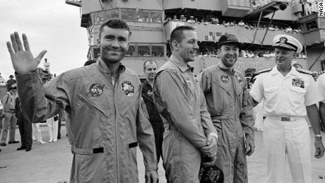 S70-35606 (17 April 1970) --- Rear Admiral Donald C. Davis, Commanding Officer of Task Force 130, the Pacific Recovery Forces for the Manned Spacecraft Missions, welcomes the Apollo 13 crewmembers aboard the USS Iwo Jima, prime recovery ship for the Apollo 13 mission. The crewmembers (from the left) astronauts Fred W. Haise Jr. (waving), lunar module pilot; John L. Swigert Jr., command module pilot; and James A. Lovell Jr., commander; were transported by helicopter to the ship following a smooth splashdown only about four miles from the USS Iwo Jima. Splashdown occurred at 12:07:44 p.m. (CST), April 17, 1970, to conclude safely a perilous space flight.