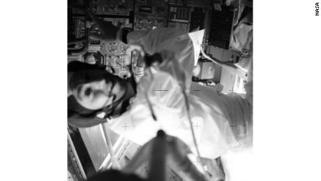 Lovell is pictured in the Lunar Module during a TV broadcast.