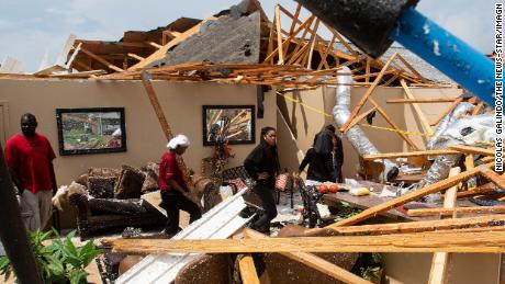 Residents look at the remains of their home after a tornado ripped through Monroe, Louisiana, on Easter Sunday.