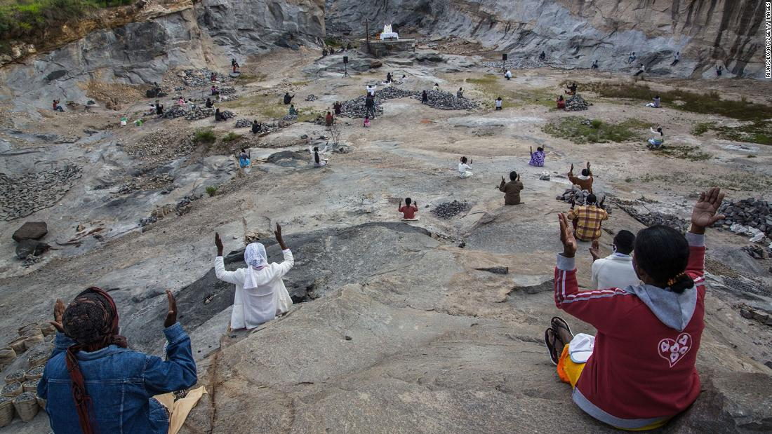 "Pedro Opeka, founder of the <a href=""http://www.amicipadrepedro.org/en/akamasoa/"" target=""_blank"">Akamasoa Association,</a> conducts the traditional Easter Mass in a granite quarry while maintaining social distancing in Antananarivo, Madagascar, on April 12."