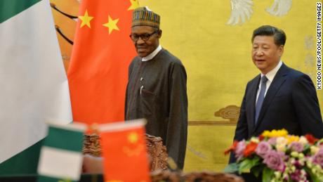 BEIJING, CHINA - APRIL 12:  President of the Federal Republic of Nigeria Muhammadu Buhari (L) and Chinese President, Xi Jinping (R) attend the signing ceremony at Great Hall of the People on April 12, 2016 in Beijing, China. (Photo by /Kyodo News - Pool/Getty Images)