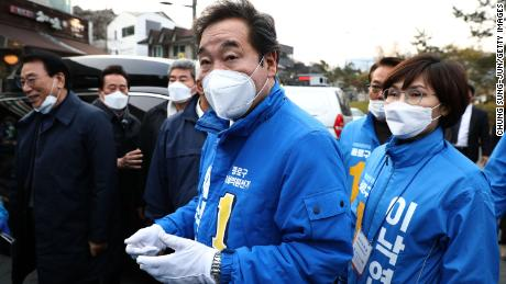 Lee Nak-yeon, a candidate of the ruling Democratic Party, wears a mask as he meets with supporters on April 10 in Seoul, South Korea.