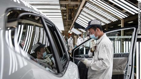 China is giving cash to car buyers to revive sales crushed by the pandemic