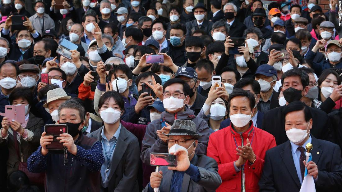 "People in Seoul, South Korea, listen to a speech from Hwang Kyo-ahn, who is campaigning for the upcoming <a href=""https://edition.cnn.com/2020/04/13/asia/elections-coronavirus-pandemic-intl-hnk/index.html"" target=""_blank"">parliamentary elections.</a>"