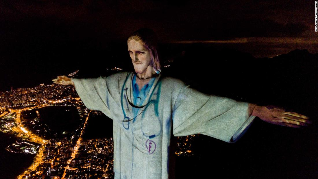 In Rio de Janeiro, the Christ the Redeemer statue was illuminated to make Christ look like a doctor on Sunday, April 12.