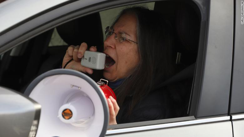 Protester Debra Cohen speaks into a megaphone at a demonstration against Immigration and Customs Enforcement in Hartford, Connecticut, on April 2.