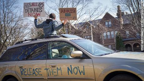 Activists who stayed mostly in their cars for social distancing honked horns outside the Governor's Residence in St. Paul, Minnesota, on March 27.