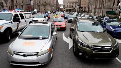 Police ticket protesters' cars blocking traffic as demonstrators in Philadelphia call for officials to release people from jails, prisons and immigration detention centers on March 30.