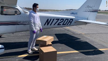 Kim loading a Cessna with supplies destined for a rural hospital in Virginia.
