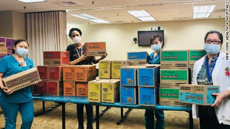 girl scout scout cookie delivery at NYC hospital during the Covid-19 crisis