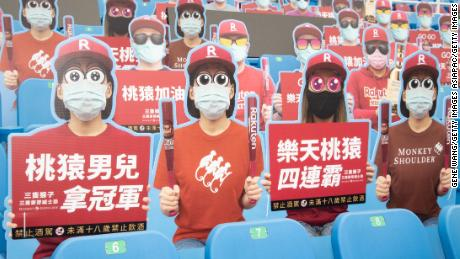 Cardboard cutouts of fans filled parts of the stadium for Saturday's washed-out baseball game.