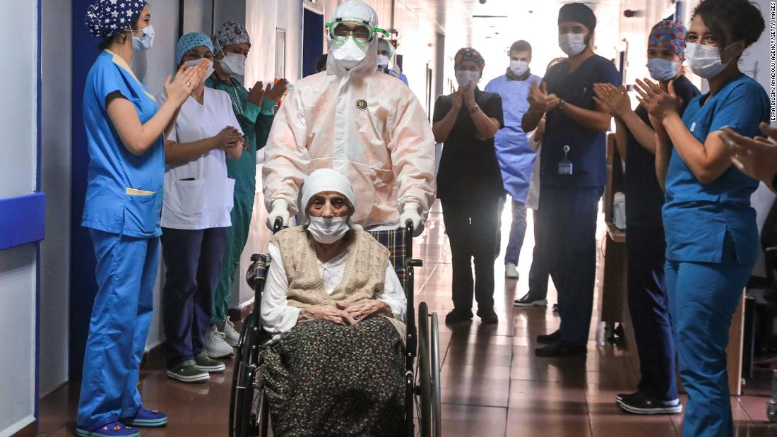 Medical workers in Istanbul clap for 107-year-old Havahan Karadeniz as she is discharged from the hospital on April 13, 2020. She had just recovered from the coronavirus.
