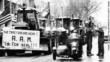 Tractors line up on 15th Street in Washington as  police attempt to keep order on February 16, 1979.