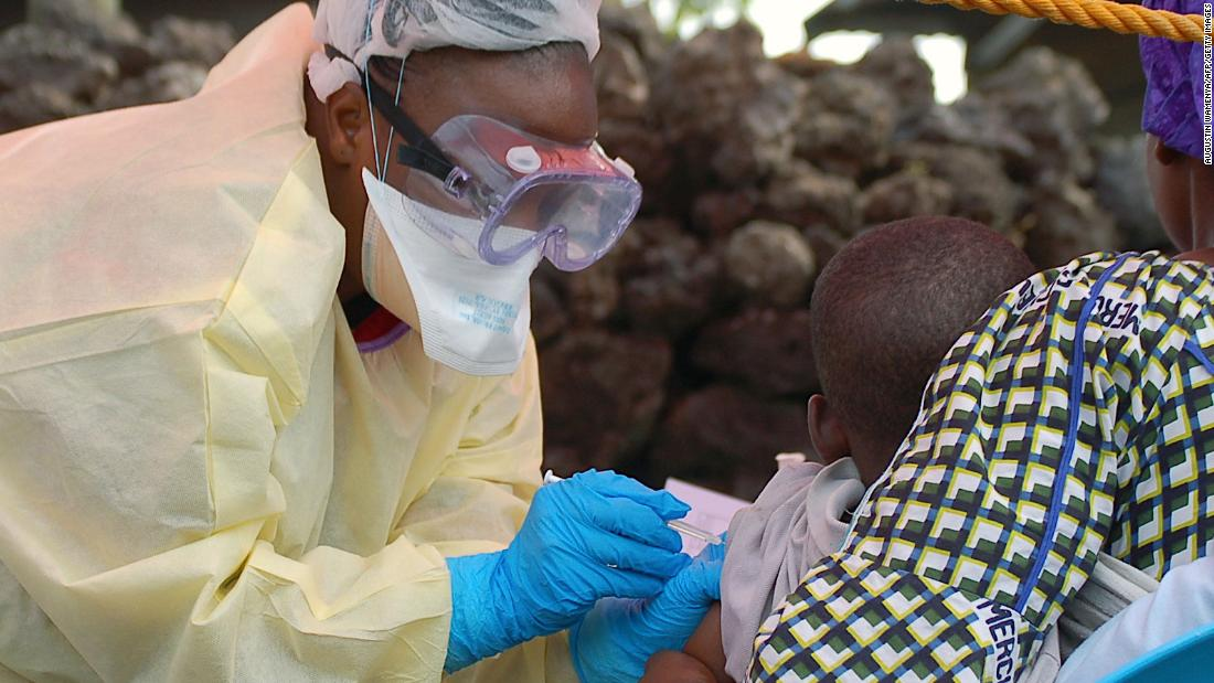 A child receives a vaccine against Ebola from a nurse in Goma on August 7, 2019. - Three cases of the deadly virus was detected in the border city of Goma, the Congolese presidency said on August 1, 2019.
