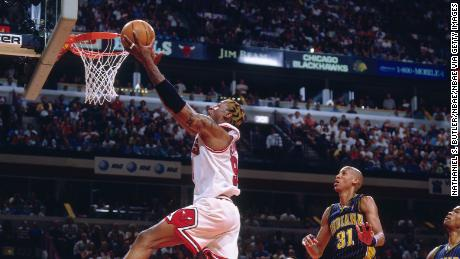 Dennis Rodman (left) in the 1998 NBA playoffs. (Photo by Nathaniel S. Butler/NBAE via Getty Images)