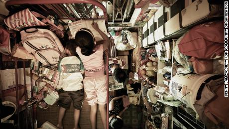 "This photograph taken by Benny Lam for the Society for Community Organization shows the inside of one of Hong Kong's ""cage homes."""