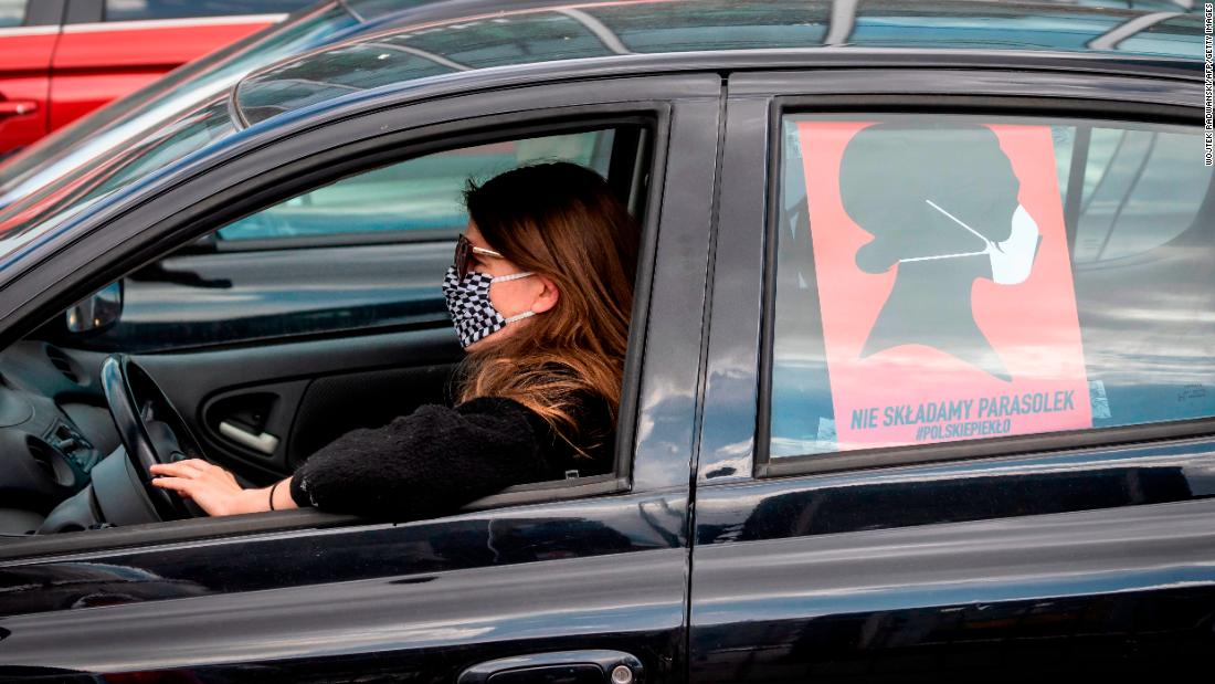 A woman drives her car during a protest of Polish women's rights activists using their cars and bicycles to block central Warsaw against a draft legislation that would ban the abortion of foetuses with congenital birth defects, on April 14, 2020. - Poland's parliament is expected to debate fresh efforts to further tighten what is already one of Europe's most restrictive abortion laws. (Photo by Wojtek RADWANSKI / AFP) (Photo by WOJTEK RADWANSKI/AFP via Getty Images)