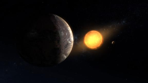 This is an illustration of newly discovered exoplanet Kepler-1649c orbiting around its host red dwarf star.