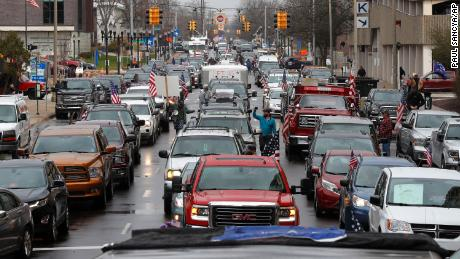Vehicles sit in gridlock during a protest in Lansing, Mich., Wednesday, April 15, 2020. Flag-waving, honking protesters drove past the Michigan Capitol on Wednesday to show their displeasure with Gov. Gretchen Whitmer's orders to keep people at home and businesses locked during the new coronavirus COVID-19 outbreak.