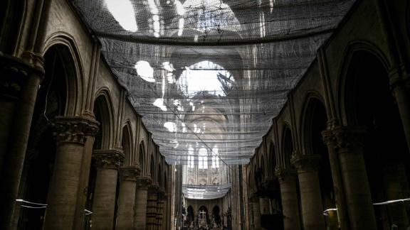 A protective net is seen installed at Notre Dame de Paris Cathedral during preliminary work on May 15, 2019, one month after the fire.
